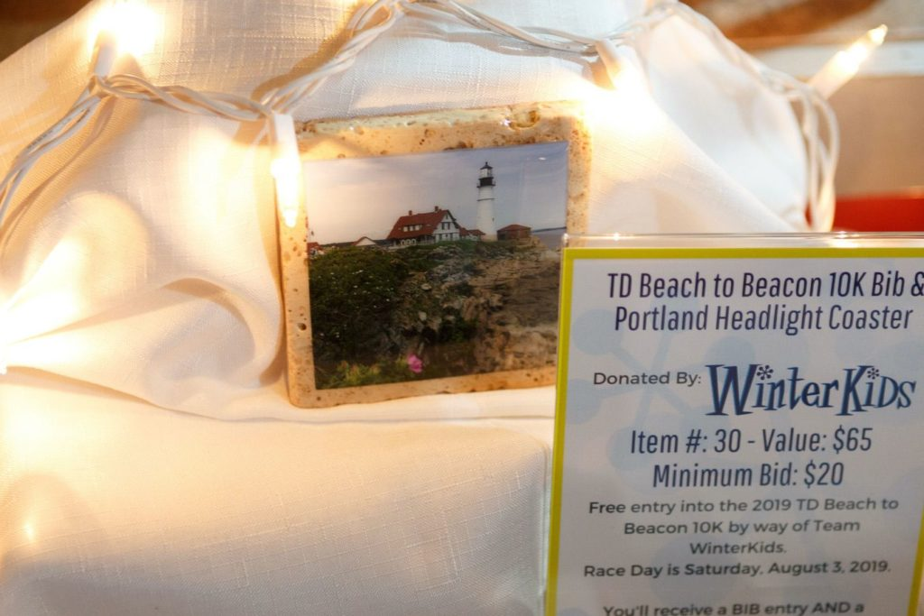 WinterKids License to Chill 2018 Auction Items TD Beach to Beacon 10K Bib and Coaster Stephen Davis Photo