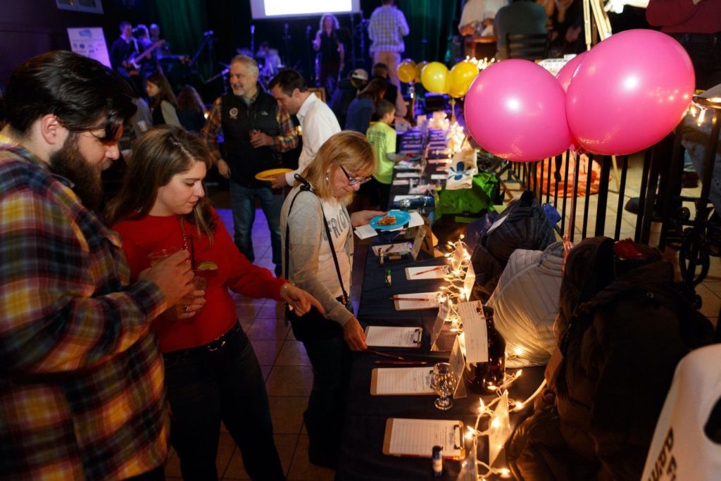WinterKids License to Chill 2018 Silent Auction in Action Stephen Davis Photo