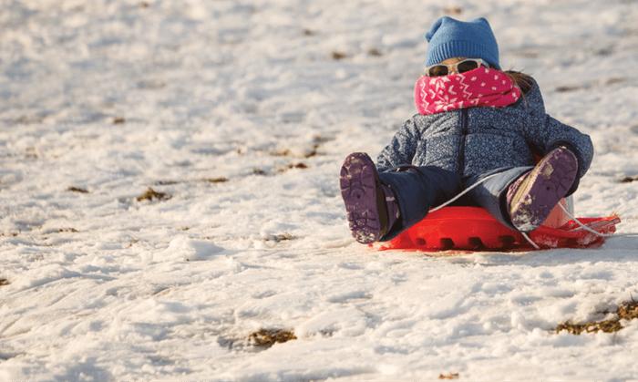 Little girl sledding